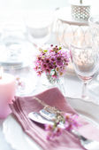 Pink flowers on a table — Stock Photo