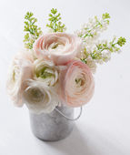 Bouquet of flowers in can — Stock Photo