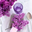 Table setting with lilac flowers — Stock Photo #45245569