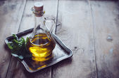 Olive oil in a vintage bottle — Stock Photo