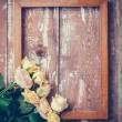 Yellow roses and a wooden frame — Stok fotoğraf