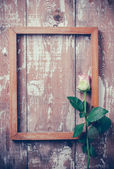 Pink roses and a wooden frame — Foto de Stock