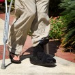 Ankle Brace Crutches - Stock Photo