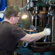 Stock Photo: Machinist Taping Threads