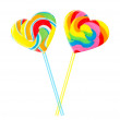Sweet couple - colourful lollipop hearts - Stock Photo