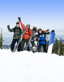 Snowboarders and skiers on mountain — Stock Photo