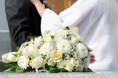 Bridal bouquet and wed couple — Stock Photo