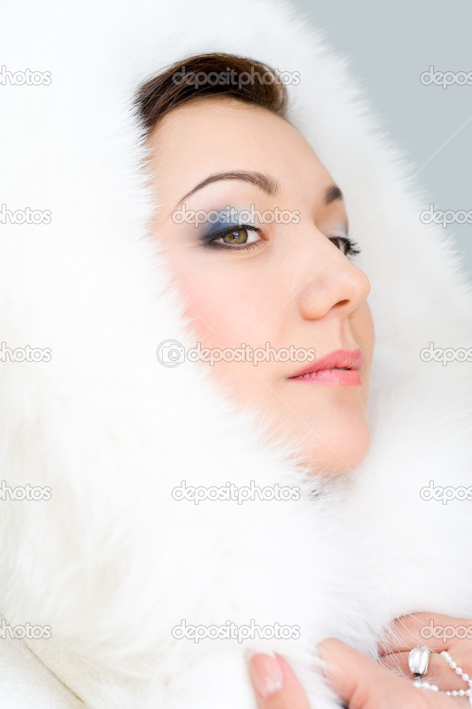 Young brunette woman in white fur hood  Stock Photo #18854725