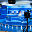 Television newscaster at TV studio — Stock Photo #19630405
