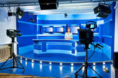 Television newscaster at TV studio — Stok fotoğraf