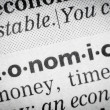 Stock Photo: Word economical in glossary, macro