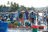 Vietnamese fishers at work — Stock Photo