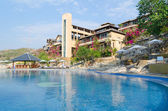 Hotel with swimming pool — Stock Photo