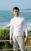 Asian young man by sea — Stock Photo