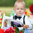 Baby boy at festive table — Stock Photo