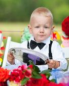 Baby boy at festive table — Stock Photo