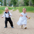Happy running babies — Stock Photo
