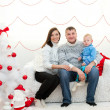Family in Christmas room — Stock Photo #39046675