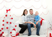 Family in Christmas room — Stock Photo