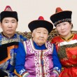 Buryat (Mongolian) grandmother and her grandchildren — Stock Photo