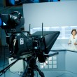 Stock Photo: Young anchorwomat TV studio