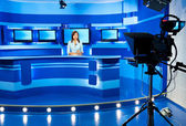 Television newscaster at blue TV studio — Stock Photo