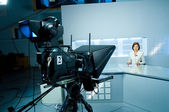 Young anchorwoman at TV studio — Stock Photo