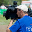Television cameraman busy at work — Stock Photo