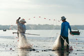 Vietnamese fishers pack their nets — Stock Photo