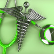 Stethoscope with symbol of medicine, caduceus. — Stock Photo #12833303