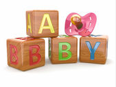 Baby from alphabetical blocks and dummy — Stock Photo