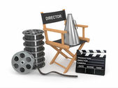 Movie industry. Producer chair, lapperboard and film reel. — Stock Photo