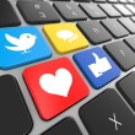Social media on laptop keyboard. — Stock Photo
