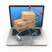 E-commerce. Shopping cart on laptop. — Stock Photo