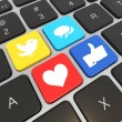 Social media on laptop keyboard. - Stock Photo