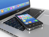 Laptop and mobile phone. — Stock Photo
