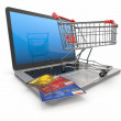 E-commerce. Shopping cart and credit cards on laptop — Stock Photo #18322209