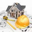 Residential house with tools on architect blueprints. - Stock Photo