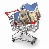 Property market. House in shopping cart — Stock Photo