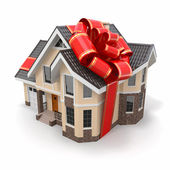 House gift. Mansion with ribbon and bow — Stock Photo