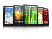 Group of digital tablet pc with different screen backgrounds — Stock Photo
