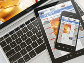 Digital news. Laptop, mobile phone and digital tablet pc — Stock Photo