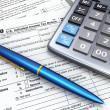 Stock Photo: Tax Return 1040, calculator and pencil. 3d