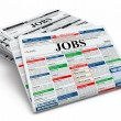 图库照片: Search job. Newspapers with advertisments.