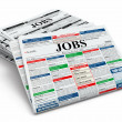 Stock Photo: Search job. Newspapers with advertisments.