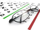 Eyeglasses and eye chart. — Stock Photo