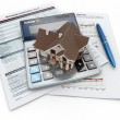 Mortgage application form with a calculator and house. — Stock Photo