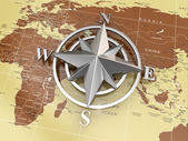 Navigation sign or compass on political map. — Stock Photo