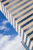 Glass, concrete and sky. Abstract building background. — Stock Photo