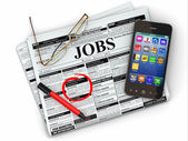 Search job. Newspaper with advertisments, glasses and mobile. — Stock Photo